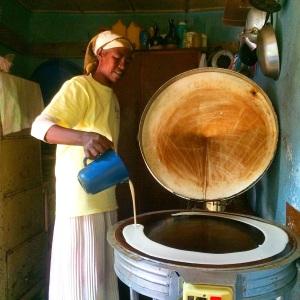 My friend Tigist making injera bread in her home.