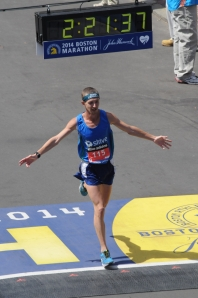Tyler Andrews crossing the 2014 Boston Marathon finish line